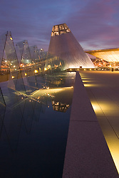 "Museum of Glass at dusk, reflecting pool with ""Hot Shop"" cone in distance, Tacoma, Washington, USA"