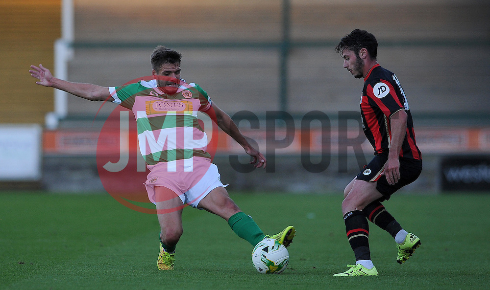 Yeovil Town's Ryan Dickson challenges for the ball with Bournemouth's Adam Smith - Photo mandatory by-line: Harry Trump/JMP - Mobile: 07966 386802 - 28/07/15 - SPORT - FOOTBALL - Pre Season Fixture - Yeovil Town v Bournemouth - Huish Park, Yeovil, England.