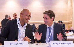 © Licensed to London News Pictures. 22/10/2018. Bristol, UK. Global Parliament of Mayors Annual Summit, 21-23 October 2018, at Bristol City Hall. Picture of MARVIN REES, Mayor of Bristol, UK, and RICARDO RIO, Mayor of Braga, Portugal. The Global Parliament of Mayors 2018 is the biggest and most ambitious Annual Summit to date. GPM Bristol 2018 will host up to 100 global mayors for an action-focused summit that addresses some of the biggest challenges facing today's world cities. GPM Bristol 2018's theme, Empowering Cities as Drivers of Change, will focus minds on global governance and the urgent need for the influence, expertise and leadership of cities to be felt as international policy is shaped. GPM Bristol 2018 will provide mayoral delegates with a global network of connections and a space to develop the collective city voice necessary to drive positive change. The programme will engage participants in decision-making, with panels, debate and voting on priority issues including migration and inclusion, urban security and health, and is a unique chance to influence decisions on the most pressing issues of our time. Photo credit: Simon Chapman/LNP