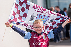 © Licensed to London News Pictures. 30/05/2015. London, UK.  A young Aston Villa supporter holds up a flag, as fans gather at Wembley Stadium for the FA Cup Final 2015, between Arsenal and Aston Villa. Photo credit : Stephen Chung/LNP