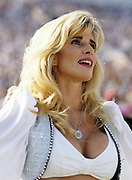 A Los Angeles Raiders cheerleader performs during the NFL football game between the New York Jets and the Los Angeles Raiders on October 10, 1993 in Los Angeles, California. The Raiders won the game 24-20. ©Paul Anthony Spinelli