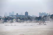 WUHAN, CHINA - NOVEMBER 23: <br /> <br /> Fog rises from Yangtze River on November 23, 2016 in Wuhan, Hubei Province of China. Fog rises from the surface of Yangtze River as the temperature in the air turns lower than the water\'s. <br /> ©Exclusivepix Media