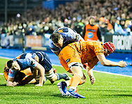 Owen Lane of Cardiff Blues is tackled by Cory Hill of Dragons<br /> <br /> Photographer Simon King/Replay Images<br /> <br /> Guinness PRO14 Round 9 - Cardiff Blues v Dragons - Thursday 26th December 2019 - Cardiff Arms Park - Cardiff<br /> <br /> World Copyright © Replay Images . All rights reserved. info@replayimages.co.uk - http://replayimages.co.uk
