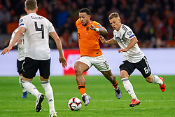 24-03-2019 NED: UEFA Euro 2020 qualification Netherlands - Germany, Amsterdam<br /> Netherlands lost the match 3-2 in the last minute / Memphis Depay #10 of The Netherlands, Joshua Kimmich #6 of Germany