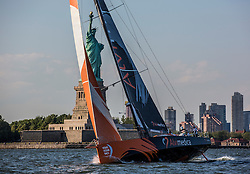 NEW YORK, NY - JUNE 22:  In this handout image provided by the Volvo Ocean Race, Team Alvimedica with American skipper Charlie Enright of Bristol, RI, arrive from Newport RI in New York, sailing by the Statue of Liberty and the Manhattan skyline. The team will formally name the boat in a public ceremony in Newport June 28. Starting from Alicante in Spain on October 04, 2014, the 38,739-nautical mile route includes stopovers in Cape Town (South Africa), Abu Dhabi (UAE), Sanya (China), Auckland (New Zealand), Itajaí (Brazil), Newport, RI,(USA), Lisbon (Portugal) and Lorient (France). A 24-hour pit-stop in The Hague is scheduled between France and the race finish in Sweden. The Volvo Ocean Race is the world's premier ocean yacht race for professional racing crews. (Photo by Daniel Forster/Team Alvimedica/go4image.com)