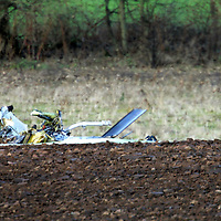 The remains of the Bell Jet Ranger 206B helicopter which crashed into a field beside the A94 Coupar Angus to Meigle road, in which two men were killed. The helicopter was being flown from Cumbernauld to Aberdeen conducting a gas pipe patrol for tthe National Grid.<br /><br />Picture by Graeme Hart.<br />Copyright Perthshire Picture Agency<br />Tel: 01738 623350  Mobile: 07990 594431