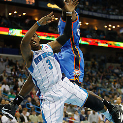 January 24,  2011; New Orleans, LA, USA; New Orleans Hornets point guard Chris Paul (3) collides with Oklahoma City Thunder forward Jeff Green (22) drawing a foul during the second quarter at the New Orleans Arena. Mandatory Credit: Derick E. Hingle
