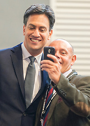 © Licensed to London News Pictures. 21/09/2014. Manchester, UK. Party Leader Ed Miliband stops for a selfie with a delegate. Labour Party Conference 2014 at the Manchester Convention Centre today 21 September 2014. Photo credit : Stephen Simpson/LNP