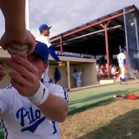 USA, Alaska, Anchorage, Minor league baseball player autographs ball before Alaska League baseball game