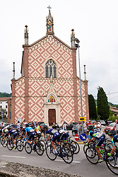 The peloton speed by a church during Stage 7 of 2019 Giro Rosa Iccrea, a 128.3 km road race from Cornedo Vicentino to San Giorgio di Perlena, Italy on July 11, 2019. Photo by Sean Robinson/velofocus.com