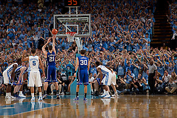 CHAPEL HILL, NC - MARCH 05: North Carolina Tar Heels fans distract and antagonize Miles Plumlee #21 of the Duke Blue Devils on March 05, 2011 at the Dean E. Smith Center in Chapel Hill, North Carolina. North Carolina won 67-81. (Photo by Peyton Williams/UNC/Getty Images) *** Local Caption *** Miles Plumlee