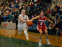 Gilford's Stevie Orton and Laconia's Kailey Nute go after a loose ball during Friday night basketball at Gilford High School.  (Karen Bobotas/for the Laconia Daily Sun)
