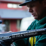 Harlan Hottenstein repairs his wife's Rockshox Boxxer fork out of his home garage in Wilson, Wyoming.