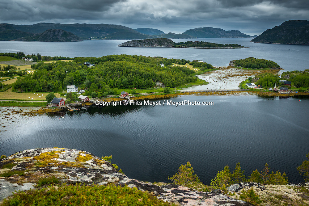 Namsos, Namdal, Trondelag, Norway, July 2015. The Hamlet of Skorstad on the wild Otteroya peninsula. Trøndelag lies at the heart of Norway's identity. The rolling hills of the interior with its traditional ox-blood coloured farm houses grow a wealth of produce. In the west the coastline is sculpted by a maze of fjords and islands home to small fishing communities. Photo by Frits Meyst / MeystPhoto.com