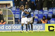 \b19 celebrates goal with Birmingham City striker Clayton Donaldson during the Sky Bet Championship match between Birmingham City and Milton Keynes Dons at St Andrews, Birmingham, England on 28 December 2015. Photo by Alan Franklin.