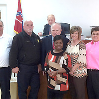 LAST DAY IN COURT<br /> (Courtesy Photo)<br /> City Court Attorney James Hood, fourth from left, retired this month and had his final day in court last week. Shown are court personnel Larry Mims, from left,  Chief Billy Voyles, Eric Chrestman, Judge Richard Bennett, Hood, Lou Huggins, Kathy Smith, Linda Griffin, Tanna Coleman and Robert Ivy.