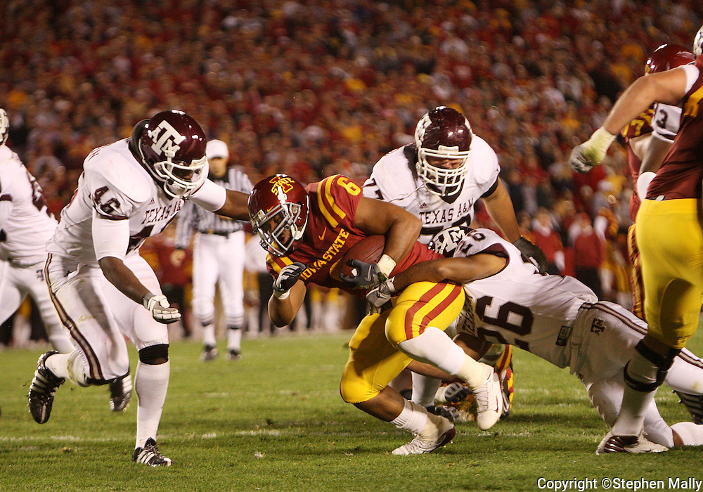 25 OCTOBER 2008: Iowa State running back Jason Scales (6) tries to pull out of the grasp of Texas A&M defensive back Devin Gregg (26) in the first half of an NCAA college football game between Iowa State and Texas A&M, at Jack Trice Stadium in Ames, Iowa on Saturday Oct. 25, 2008. Texas A&M beat Iowa State 49-35.