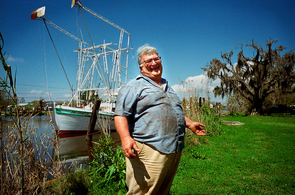 Cajun speaking Aswell Domangue, 42, in front of his shrimp boat on the Bayou - Chauvin, Louisiana...