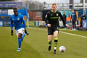 Nathan McGinley and Arthur Gnahoua in action during the EFL Sky Bet League 2 match between Macclesfield Town and Forest Green Rovers at Moss Rose, Macclesfield, United Kingdom on 25 January 2020.