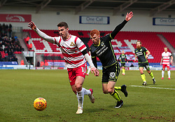 Rory Gaffney of Bristol Rovers challenges Tommy Rowe of Doncaster Rovers - Mandatory by-line: Robbie Stephenson/JMP - 27/01/2018 - FOOTBALL - The Keepmoat Stadium - Doncaster, England - Doncaster Rovers v Bristol Rovers - Sky Bet League One