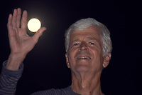 Life Long Learner Holding the Moon. Image taken with a Fuji X-T1 camera and 55-200 mm VR lens