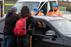 Harefield, UK. 8 February, 2020. A HS2 engineer films a local motorist showing his frustration at being delayed at a HS2 roadblock on Harvil Road in the Colne Valley. Both road and rail closures were implemented by HS2 in order to enable tree felling work for the high-speed rail link. Environmental activists based at a series of wildlife protection camps in the area prevented the tree felling works for the duration of the weekend for which they were scheduled.