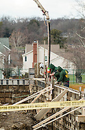 Middletown, New York - Workers pour cement for the foundation of the building that will house the new pool at the YMCA of Middletown on Dec. 3, 2015.