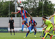 Luke Croll leaps highest for the header during the U21 Professional Development League match between Crystal Palace U21s and Huddersfield U21s at Imperial Fields, Tooting, United Kingdom on 7 September 2015. Photo by Michael Hulf.