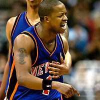10 March 2007:   New York Knicks guard Steve Francis (r) is restrained by teammate forward Channing Frye (l) after being called for a technical foul in the second half in the game against the Washington Wizards at the Verizon Center in Washington, D.C.  The Knicks defeated the Wizards 90-89.