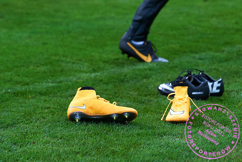 Nike's shoes lie on the pitch during official training one day before the EURO 2016 qualifying match between Poland and Germany on October 10, 2014 at the National stadium in Warsaw, Poland<br /> <br /> Picture also available in RAW (NEF) or TIFF format on special request.<br /> <br /> For editorial use only. Any commercial or promotional use requires permission.<br /> <br /> Mandatory credit:<br /> Photo by &copy; Adam Nurkiewicz / Mediasport