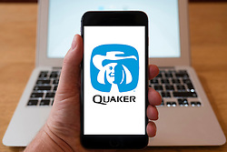 Using iPhone smartphone to display logo of Quaker Oats company