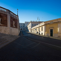 """An elder couple climbing their way up via della Dataria - the street that connects """"Quirinale"""" hill (where the current official residence of the President of the Italian Republic is located - in this picture just left of frame) to Trevi (and the famous fountain)."""