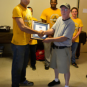 BRONX, NY - 8/18/2018 - U.S. Navy Chief Select Hospital Corpsman Alejandro F. Dominguez shakes hands with Bill Franklin, member of Samuel H. Young American Legion Post 620 on Saturday. Dominguez and his class of Chief Selects from Navy Operational Support Center New York volunteered at the post as part of a Navy leadership program called CPO365 Phase II.  (U.S. Navy Photo by Chief  Mass Communication Specialist Roger S. Duncan / RELEASED )