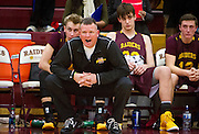 Northfield Raiders head coach Andy Berkvam calls a set play during the first half of the high school basketball game between Northfield and Rochester Century, Tuesday, December 10, 2013.