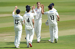 Benny Howell of Gloucestershire celebrates with his team mates after catching out Paul Horton of Lancashire - Photo mandatory by-line: Dougie Allward/JMP - Mobile: 07966 386802 - 07/06/2015 - SPORT - Football - Bristol - County Ground - Gloucestershire Cricket v Lancashire Cricket - LV= County Championship