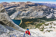 Rock climber on Tenaya Peak, Tuolumne Meadows, Yosemite National Park, California