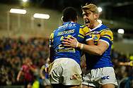 Kallum Watkins (L) of Leeds Rhinos celebrates scoring his teams 3rd Try against Hull FC with team mate Jack Ormondroyd (R) during the Betfred Super League match at Emerald Headingley Stadium, Leeds<br /> Picture by Stephen Gaunt/Focus Images Ltd +447904 833202<br /> 08/03/2018