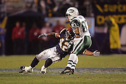SAN DIEGO, CA - JANUARY 8:  Wide receiver Santana Moss #83 of the New York Jets gets tackled by safety Clinton Hart #42 of the San Diego Chargers. Moss caught 4 passes for 100 yards and one touchdown at Qualcomm Stadium on January 8, 2005 in San Diego, California. The Jets defeated the Chargers 20-17 in overtime in the AFC Wild Card Game. ©Paul Anthony Spinelli  *** Local Caption *** Santana Moss; Clinton Hart