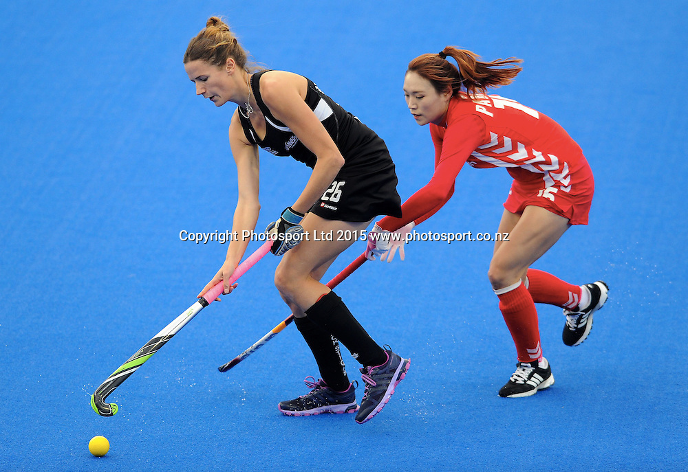New Zealand Black Stick Pippa Hayward under pressure from Koreas Eunjung Park in the Festival of Hockey, New Zealand Womens Black Sticks v Korea, Unison Sports Park, Hastings, Saturday, April 118 2015. Photo: Kerry Marshall / photosport.co.nz