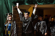 An undergraduate student triumphantly enters the Convocation Center prior to the start of the afternoon commencement ceremony on Saturday, May 2, 2015.  Photo by Ohio University  /  Rob Hardin