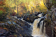 A Scottish Waterfall, the Rogie Falls, in Autumn.<br />
