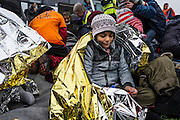 March 1, 2016 - Athens, Greece - <br /> <br /> Children as escorted as migrants and refugees arrive on the Greek island of Lesbos while crossing the Aegean Sea from Turkey on March 2, 2016, in Mytilene...The EU on March 2 proposed 700 million euros in emergency aid for Greece and other states as it began to tackle the migrant crisis within its borders like humanitarian disasters in developing countries. So far, more than 131,000 migrants have crossed the Mediterranean to reach Europe this year, UN figures show -- more than the total number for the first five months of 2015. Last year, a million landed on Europe's shores.<br /> ©Exclusivepix Media