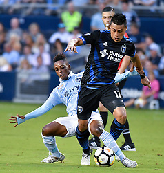 Sporting Kansas City forward Latif Blessing, left, tries to free the ball from San Jose Earthquakes midfielder Darwin Ceren in the first half of the U.S. Open Cup semifinals at Children's Mercy Park in Kansas City, Kan., on Wednesday, Aug. 9, 2017. (Photo by John Sleezer/Kansas City Star/TNS/Sipa USA) *** Please Use Credit from Credit Field ***