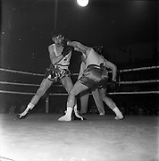 26/01/1962<br /> 01/26/1962<br /> 26 January 1962<br /> Irish Amateur National Junior Boxing Championships, at the National Stadium, Dublin.  G. Young, (right) Achilles B.C., Belfast lands a left to the jaw, while avoiding a left from J. Hanna, Donegal, Boxing Club during the Welterweight final. Young won on points.
