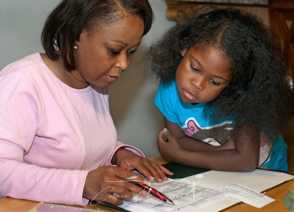 Veda Eady reviews school papers with her daughter, Hannah, Oct. 27, 2009 in Madison, Ala. Mrs. Eady and her husband, Levern Eady, chose to relocate to the Huntsville metropolitan area for the intellectually-rich environment it provides for their children as well as its future economic potential. Analysts expect Huntsville to fare well in the new economy thanks to its strong aerospace, defense, and biotech industries. (Photo by Carmen K. Sisson/Cloudybright)