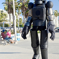 A robot walks along the Santa Monica Boardwalk on Wednesday, January 16, 2013. It was an interactive public art performance.