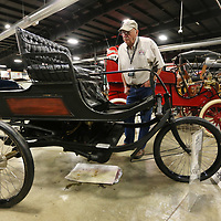 Willy Vinton, Manager of the Fountainhead Antique Auto Museum in Fairbanks Alaska, looks over the 1899 Knox as a possible addition to his museum as her attends Bonhams preview day at the Tupelo Automobile Museum on Thursday morning.