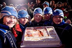 Young cross-country skiers with a cake when Slovenian athlete Petra Majdic celebrates with her home town when she arrived home with small cristal globus at the end of the nordic season 2008/2009, on March 24, 2009, in Dol pri Ljubljani, Slovenia. (Photo by Vid Ponikvar / Sportida)
