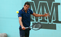 May 8, 2018 - Madrid, Spain - Guillermo Garcia Lopez of Spain plays a backhand to Ryan Harrison of USA in the 2nd Round match during day four of the Mutua Madrid Open tennis tournament at the Caja Magica. (Credit Image: © Manu Reino/SOPA Images via ZUMA Wire)