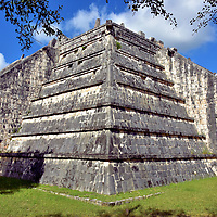 The Ossuary at Chichen Itza, Mexico<br /> South of the Great North Platform buildings is the Ossario Group. The namesake is this step pyramid called The Ossuary. Alternatively spelled Osario (burial place), its design is similar to El Castillo but it is considerably shorter at 29.5 feet. It was also called the Tomb of the High Priest (La Tumba del Gran Sacerdote) when archeologists discovered artifacts and seven skeletal remains at the bottom of a 39 foot deep, central cave during the late 19th century. Experts now dispute the tombs belonged to high priests.